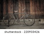 vintage bicycle leaning against ...   Shutterstock . vector #220933426