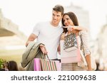 young couple shopping walks... | Shutterstock . vector #221009638