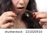 girl looking at damaged... | Shutterstock . vector #221020510