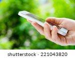 woman using a smart phone | Shutterstock . vector #221043820