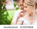 embrace the bride and groom | Shutterstock . vector #221055868