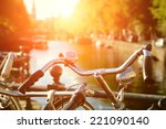 Stock photo amsterdam view with bicycles under sun light 221090140
