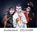 Stock photo three adults dressed in halloween costumes 221114389