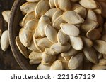 roasted salty pumpkin seeds... | Shutterstock . vector #221167129