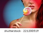sexy girl licks  lollipop on... | Shutterstock . vector #221200519