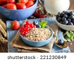rolled oats in a blue bowl on a ... | Shutterstock . vector #221230849
