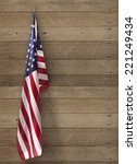 flag usa hanging on wooden wall | Shutterstock . vector #221249434
