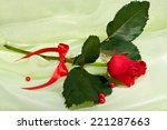 red rose with beads and red... | Shutterstock . vector #221287663