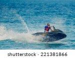 Young Man On Jet Ski  Tropical...