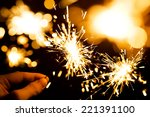 Man's Hand Holding A Sparkler