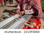 The Woman Weaves Multi Colored...