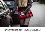 sexy blond girl keying a black... | Shutterstock . vector #221398360