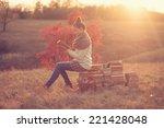 hipster girl reading at sunset | Shutterstock . vector #221428048