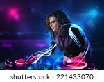 beautiful disc jockey playing... | Shutterstock . vector #221433070