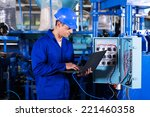 industrial programmer checking... | Shutterstock . vector #221460358