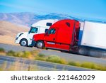 two speeding semi trucks on the ... | Shutterstock . vector #221462029