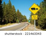 Watch For Bears Yellow Caution Street Sign in Sierra Nevada Mountains in California, USA. - stock photo