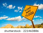 Road May Flood Warning Sign In...