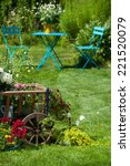 wooden cart with flowers in a... | Shutterstock . vector #221520079