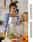 young woman eating fresh salad... | Shutterstock . vector #221544370