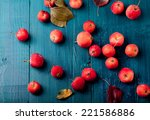 Red Apples And Leaves On A...