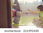 Stock photo a little cute boy playing with cat 221592430