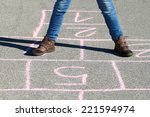 human legs in jeans and boots... | Shutterstock . vector #221594974