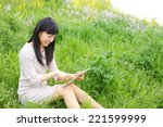 young woman using tablet...   Shutterstock . vector #221599999