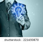 business man touching light of... | Shutterstock . vector #221650870