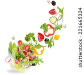 fresh salad with flying... | Shutterstock . vector #221665324