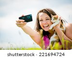 Woman Taking Photo With Mobile...