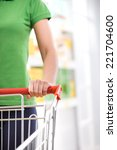 young woman with trolley at... | Shutterstock . vector #221704600