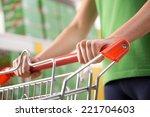 woman in green t shirt pushing... | Shutterstock . vector #221704603