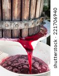 red wine grapes being crushed... | Shutterstock . vector #221706940