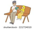 man reading book to a little... | Shutterstock .eps vector #221724010