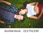 couple lying on grass | Shutterstock . vector #221741230