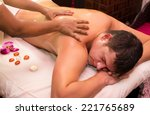 man engaged in ayurvedic spa... | Shutterstock . vector #221765689