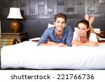 Stock photo a happy young couple on their vacations lying on the bed in an asian style hotel room 221766736