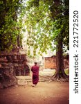 Buddhist Monk At Ancient Ruins...