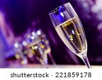 glass with champagne lit by... | Shutterstock . vector #221859178