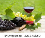 Red Wine Glass And Bottle With...