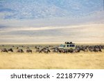 safari tourists on game drive... | Shutterstock . vector #221877979