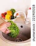 vegetables washing in kitchen   Shutterstock . vector #221905318