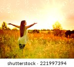 happy girl on the meadow at... | Shutterstock . vector #221997394