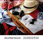 suitcase packed with clothes   Shutterstock . vector #222022510