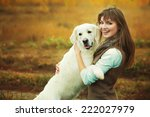 Stock photo young golden retriever for a walk with his owner dog breed labrador outdoors 222027979