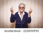 cool elder lady making middle...   Shutterstock . vector #222053953