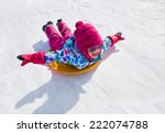 Little Girl Riding On Snow...