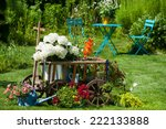 wooden cart with flowers in a... | Shutterstock . vector #222133888