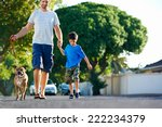 Stock photo a father walking with his dog and his son in the suburbs 222234379